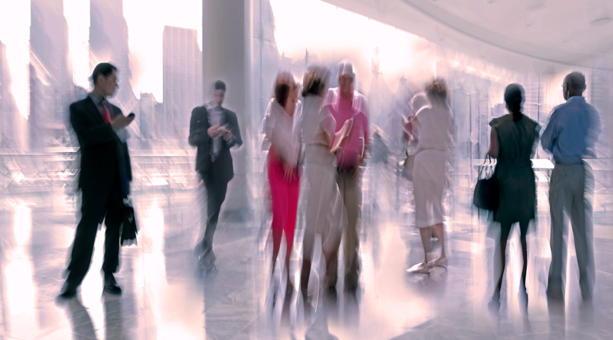 Business people in motion blur